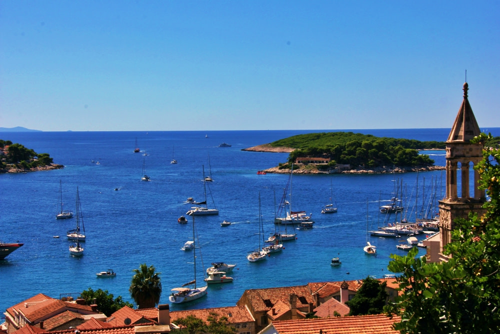 Sailboats gathering in the bay in front of Hvar