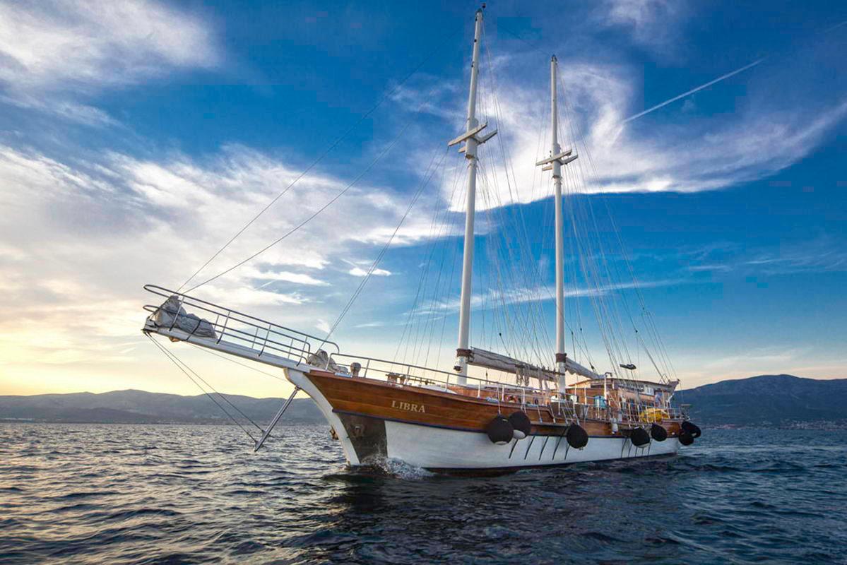 Side view of a sailing gulet at sea at dusk