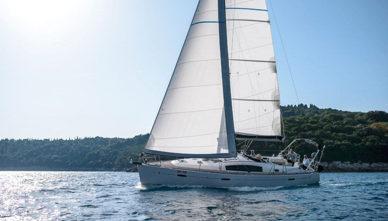 Side view of an Oceanis 40 sailing on a sunny day