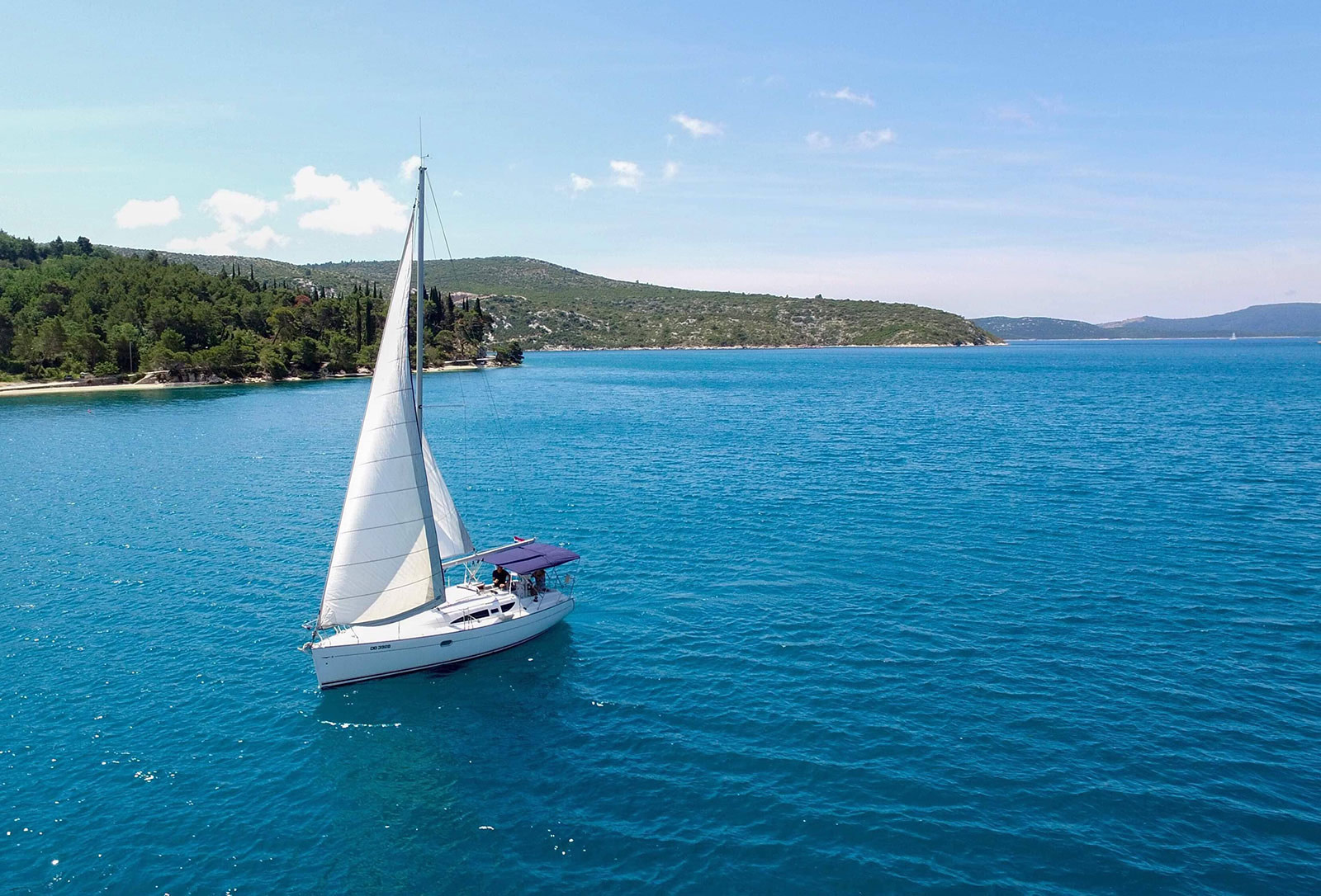 Birds view of a Sun Odyssey 32 sailing in Croatia