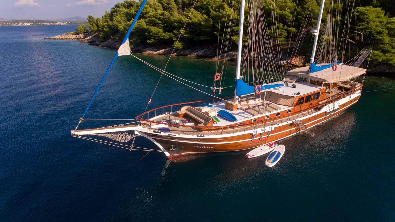 Aerial view of a wooden gulet ship anchored near an island
