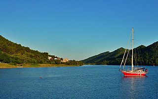 Photograph of sailboats anchored in a Peljesac bay