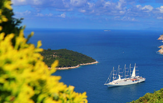 Photograph of a sail ship and Dubrovnik