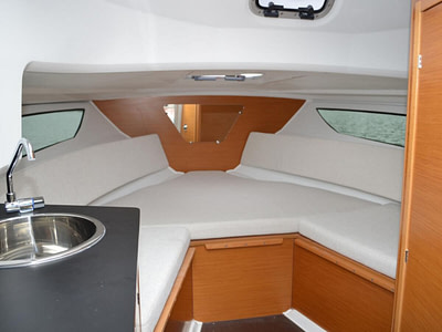 Sink and wooden saloon inside of a Cap camarat speed boat