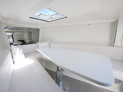 vandutch speedboat saloon with white table and cushions
