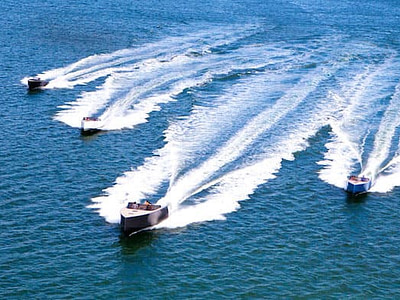 Five speed boats gliding on the crystal blue Adriatic sea in Croatia