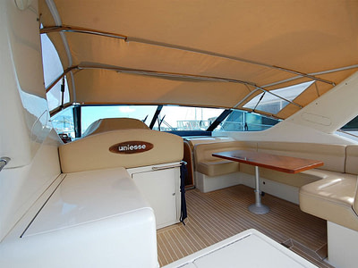 Speedboat with brown sunshade docked