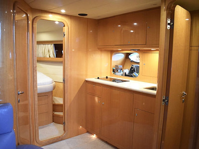wooden kitchen and entrance to a double room cabin on a motor boat