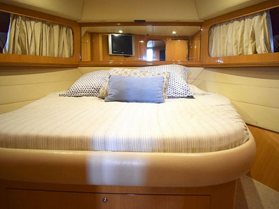 Modern boat cabin with a double bed