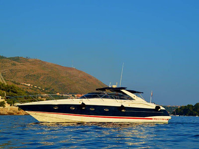 motor boat Sunseeker 50 for charter is floating in Dubrovnik beautifull port. The weather outside is sunny and worm.