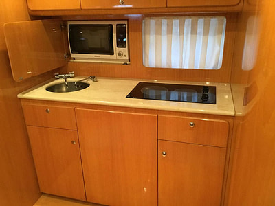 wooden kitchen in natural colour on the uniesse yacht in Dubrovnik, Croatia