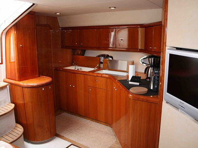 Spacious boat saloon equipped with tv and full kitchen