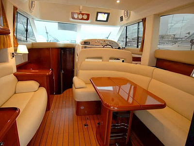 Interior of a motor boat with a comfortable leather couch in the cockpit