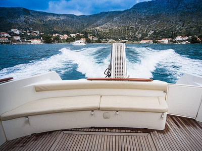 Motor yacht with teek deck glides in Ombla river in Dubrovnik,Croatia