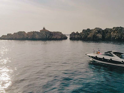 guests who rented the boat sunseeker 50 are chilling o the boat bow in front of the Grebeni reefs in Dubrovnik area