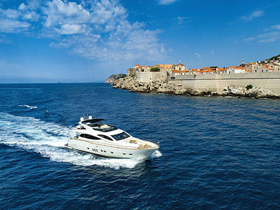 yacht alone on the sea, with a view of the city walls of Dubrovnik i croatia
