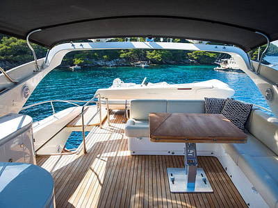 flybridge of luxury yacht with comfortable sofa full of cushions available for rent in dubrovnik