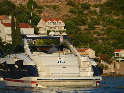 boat sunseeker 50 for rent is floating next to the Daksa island in Dubrovnik, Croatia