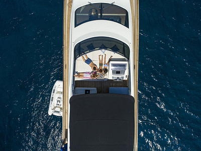 kids on the flybridge of luxury yacht with comfortable mattress available for rent in dubrovnik