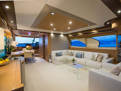 luxury yacht saloon with L shape sofa, glass table and with huage windows available for rent in dubrovnik, croatia