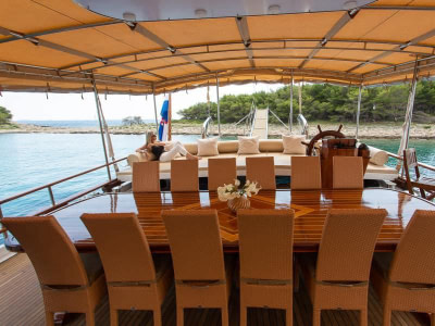 Outdoor dining table onboard s luxury wooden ship