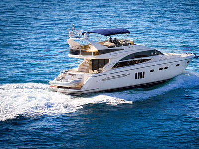 Side view of motor yacht Princess 62 cruising on sea