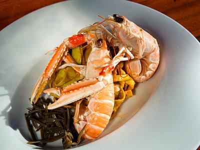 Shrimp pasta dish served on a white plate