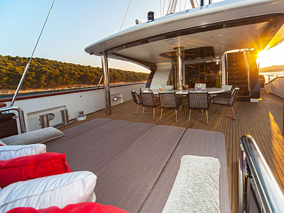 Spacious outdoor lounge sofa and dining area on a Navilux yacht