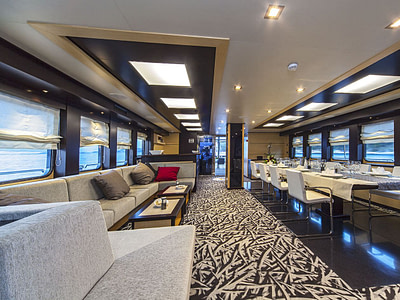 Modern interior lounge and dining area inside a luxurious sailing yacht