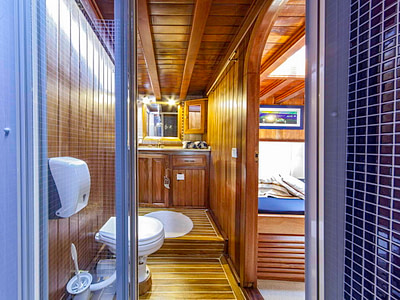Shower and toilet inside a wooden ship cabin