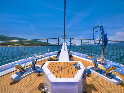Bow of a luxury wooden gulet with views of the adriatic sea