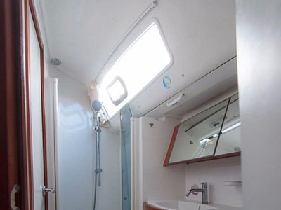 Guest bathroom with a toilet and shower onboard Oceanis 40