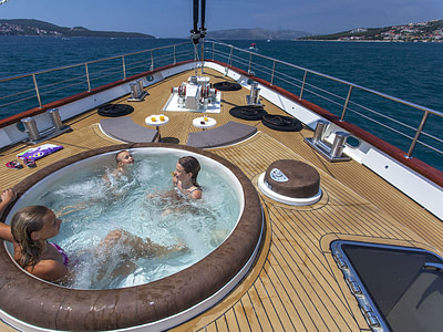 Family in an outdoor hot tub on Navilux sailing yacht