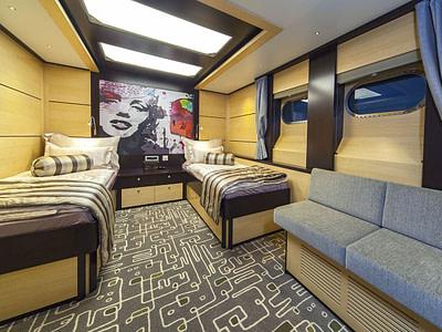 Modern twin cabin with sofa