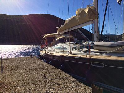 Sailing boat docked at bay on a sunny day