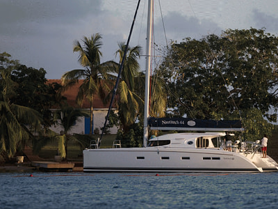Nautitech 44 docked at an island with palm trees