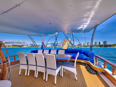 Outdoor dining area onboard wooden ship