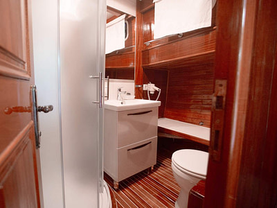 Private guest bathroom with shower on a wooden ship