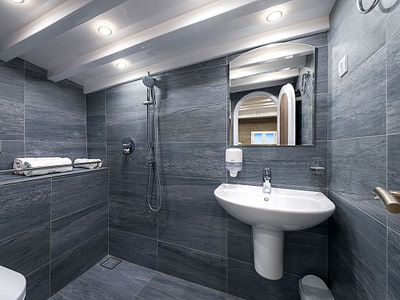 Ensuite bathroom made of stone with a shower