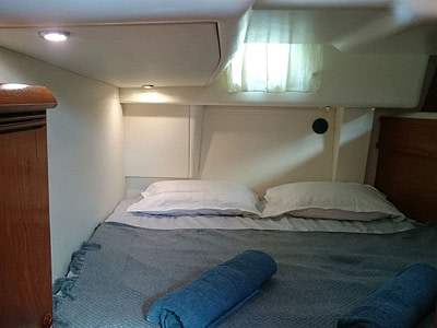 Double bed in a guest cabin in a sailing boat