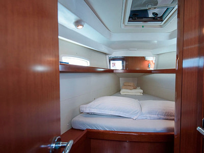 Bed inside a cabin on a sailing boat for rent