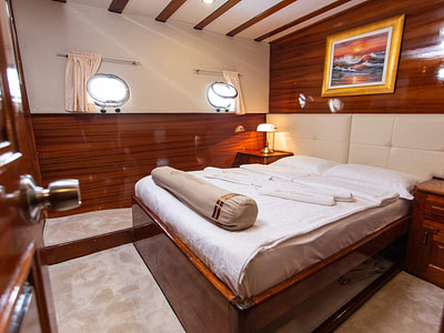 Double bed in cabin on luxury gulet