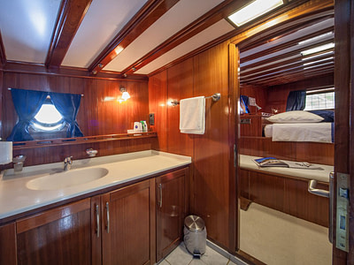 Ensuite bathroom inside a guest cabin on a ship