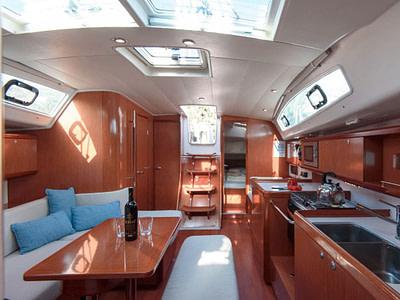 Indoor saloon and kitchen onboard an Oceanis 40