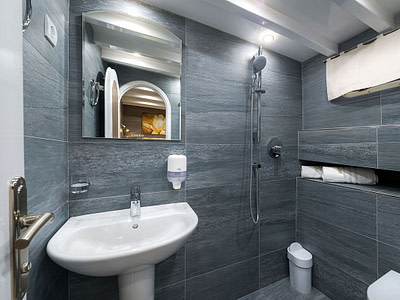 Luxury stone indoor bathroom with a shower and sink