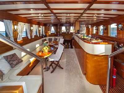 Indoor bar and lounge onboard a gulet for rent