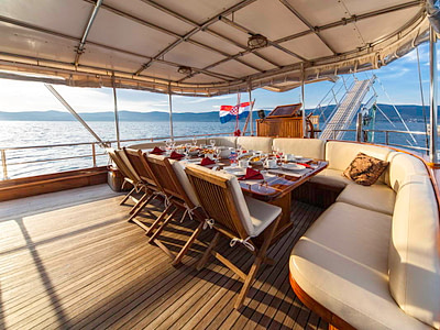 Outdoor dining table and chairs on a gulet ship