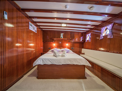 Double bed in a luxurious cabin on a ship