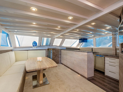 Luxurious wooden saloon with leather couch onboard a gulet