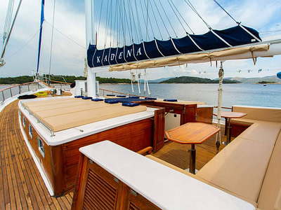 Spacious outdoor sundeck and lounge area on a luxury wooden ship
